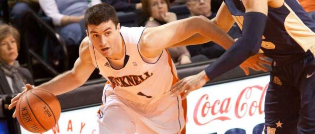 Bryan Cohen taking the ball down court for Bucknell Bison against Navy.