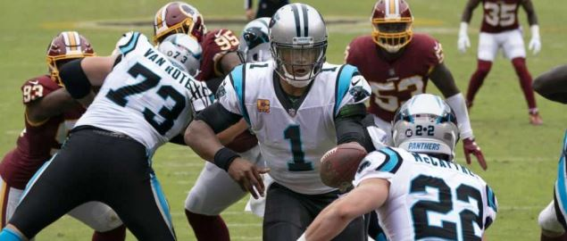 Cam Newton passes the ball to Mccaffrey during game against the Redskins.