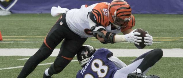 Cincinnati Bengals' player dives with the ball during games against the Ravens.