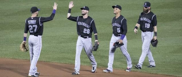 The Colorado Rockies celebrate a win against the Baltimore Orioles.