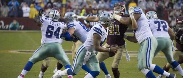 The Dallas Cowboys quarterback gets out of the pocket against Washington.