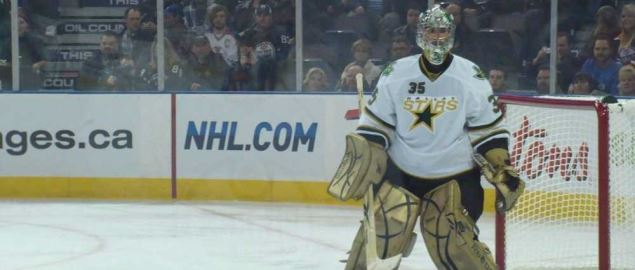 The Dallas Stars goalie defending the goal against the Edmonton Oilers.