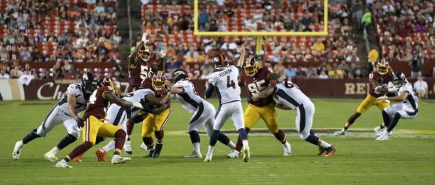 Case Keenum attempting a pass during the Broncos vs. Redskins game.