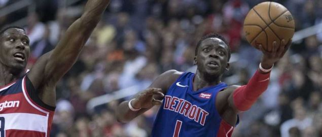 Reggie Jackson of the Detroit Pistons goes for a layup against the Wizards.