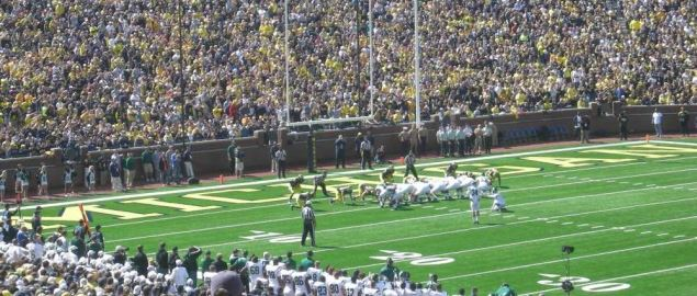 Eastern Michigan kicking a field goal against the Michigan Wolverines.