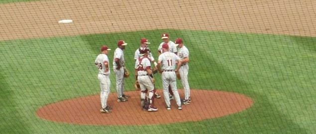 Mike Martin visits the mound to coach members of the 2010 Florida State baseball team.