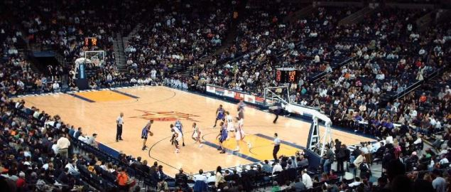 The Golden State Warriors playing against the Sacramento Kings.