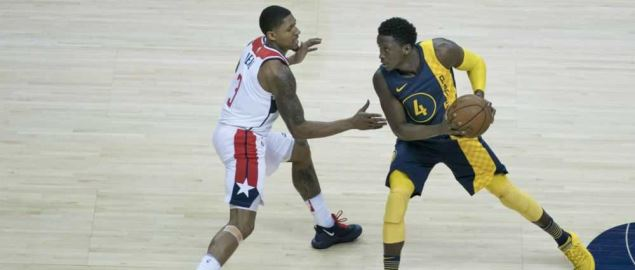 Victor Oladipo of the Indiana Pacers takes the ball down court against the Wizards.
