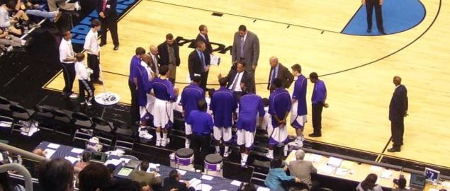 Coach talking to the LSU Tigers during timeout.