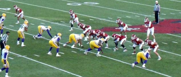 LSU Tigers lined up on defense against the Razorbacks at Reynolds Razorback Stadium.