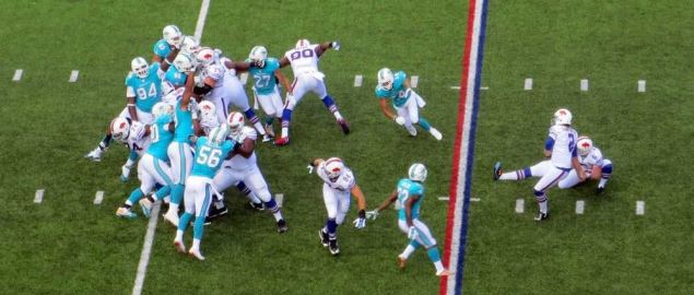 The Miami Dolphins attempt to block a punt by the Buffalo Bills.
