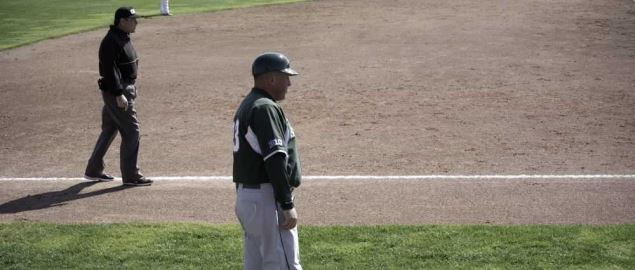 Jake Boss coaches third base and manages the Michigan State Spartans during a 2012 game.