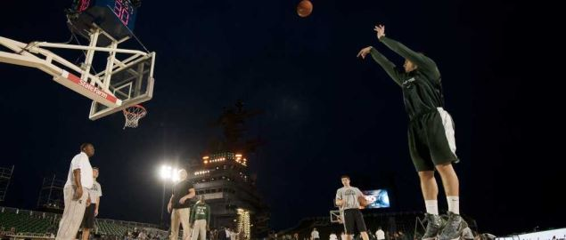 The Michigan State Spartans team practicing on the deck of the Nimitz-class.