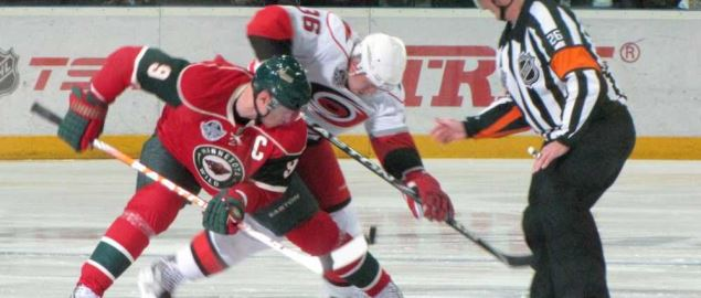 Face off during the Minnesota Wild vs. Carolina Hurricanes game.