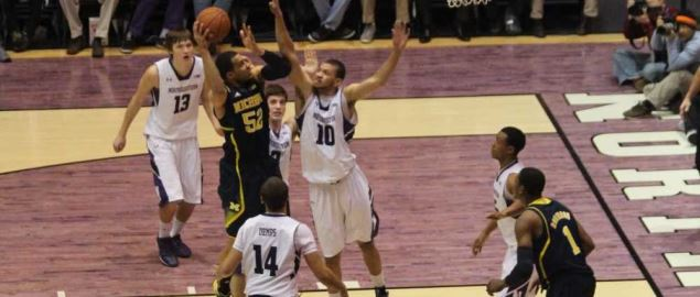 The Northwestern Wildcats defend against the Michigan Wolverines.