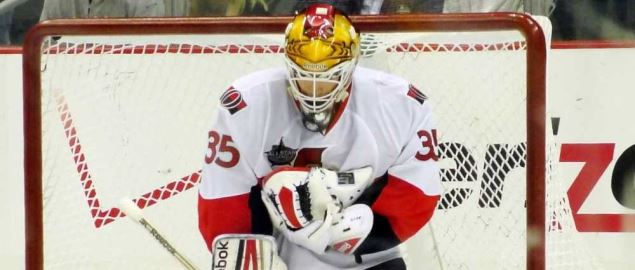 The Ottawa Senators goalie making a save against the Pittsburgh Penguins.