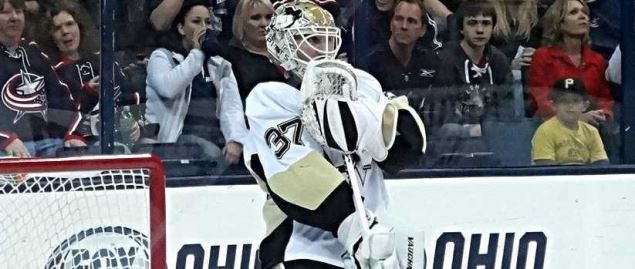Pittsburgh Penguins goalie preparing before a game against the Columbus Blue Jackets.