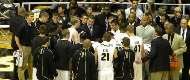 Purdue Boilermakers men's basketball team huddles during a game.