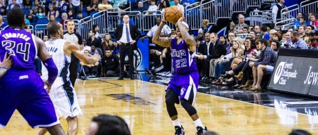 Sacramento Kings' Isaiah Thomas attempts a three-pointer vs. the Orlando Magic.