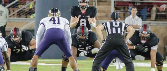 Stanford quarterback Hogan snapping the ball at Foster Field.
