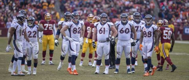Teams watch the board at the Broncos vs. Redskins game.