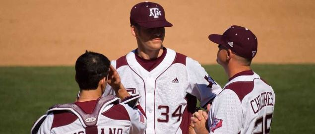 Texas A&M Aggies players group to talk during a game.