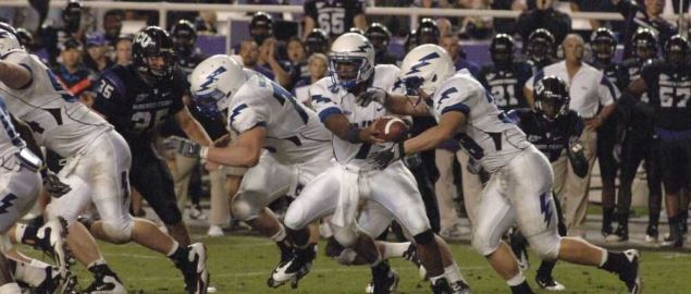 The TCU Horned Frogs defense attempt to tackle Air Force quarterback.