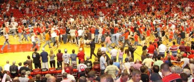Texas Tech students and fans rushing the court after the Red Raiders upset the Longhorns.