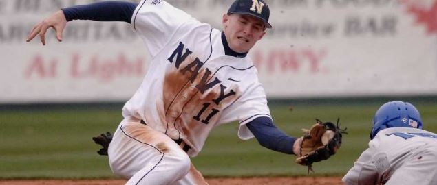Navy shortstop Nick Driscoll catches the rifled throw from Navy catcher Steve Soares.