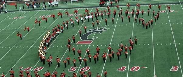 The UC Bearcat Band forms a C-Paw during Halftime.