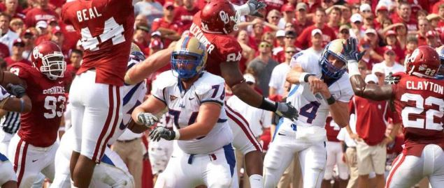 Tulsa Golden Hurricane quarterback passes the ball during a game against the Sooners.