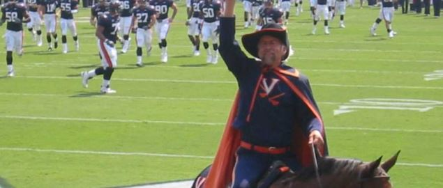 The Virginia Cavaliers mascot exciting the crowd during a game.