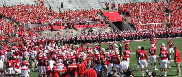 The Wisconsin Badgers football team gathers right before the start of their game.
