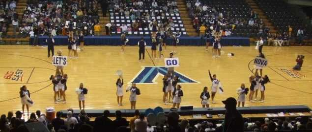 The Villanova Wildcats cheerleaders cheering during halftime.