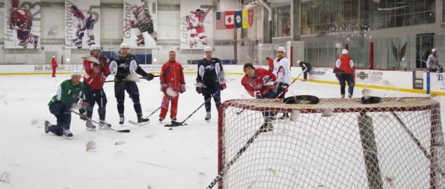 The Washington Capitals practice shooting the puck.