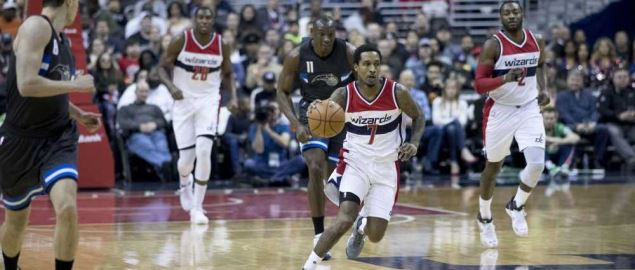 The Washington Wizards bring the ball down the court against the Magic.