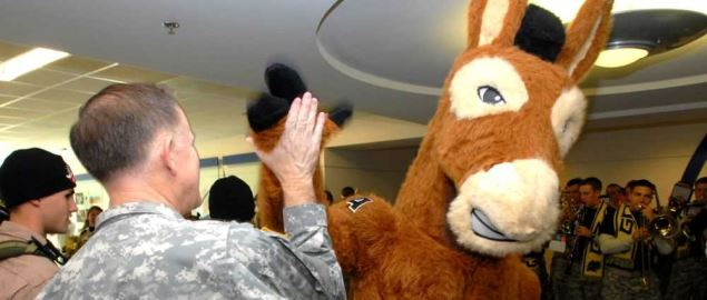 Army mascot Black Jack high fiving Army Major General Douglas Carver.
